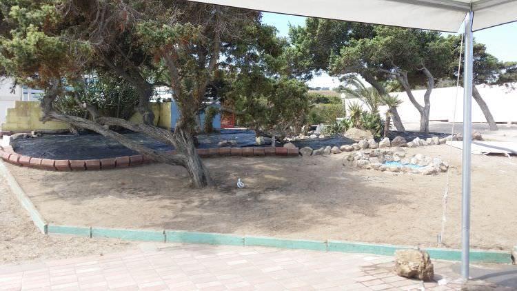lavori prato in erba sintetica al Cafè Set Beach Platamona, Sassari
